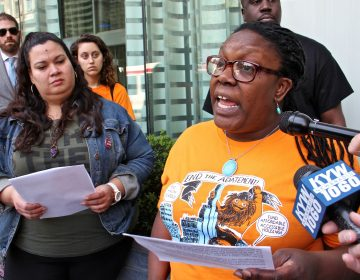 Kendra Brooks (right), Working Families Party candidate for City Council, joins  members of 215  People's Alliance in calling for an end to the city's tax abatement program. (Emma Lee/WHYY)