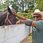 Concrete Cowboys founder Malik Divers and his horse Sunny. (Kimberly Paynter/WHYY)