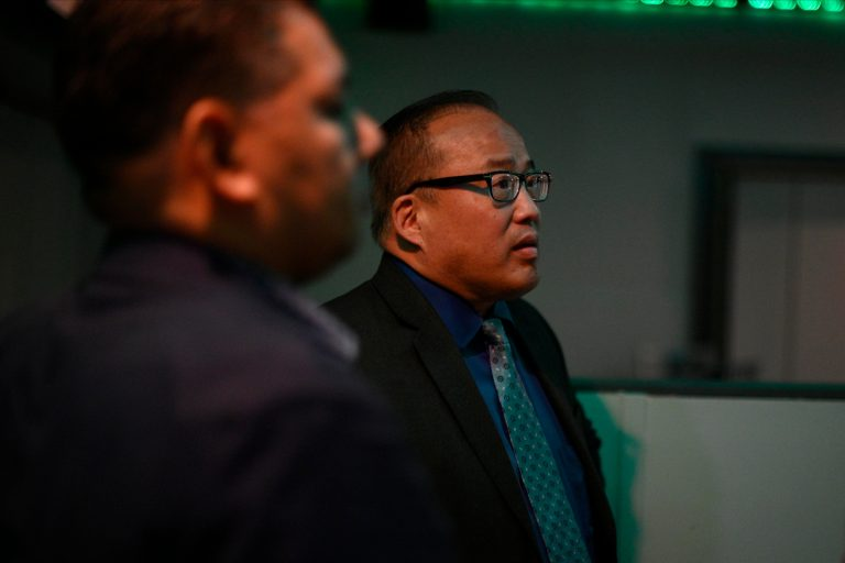 Incumbent Councilman at-Large David Oh follows the results at Dimensions Sports Bar in Northeast Philadelphia. (Bastiaan Slabbers for WHYY)