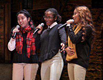 Northeast High School students Anna Tran, Tatyanna Roldan and Jovita Deguzman perform