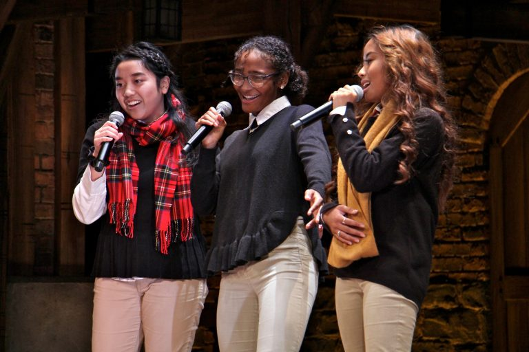 Northeast High School students Anna Tran, Tatyanna Roldan and Jovita Deguzman perform