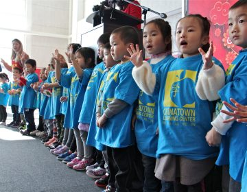 Young students from the Chinatown Learning Center sing during the grand opening of the Crane Chinatown community center. (Emma Lee/WHYY)