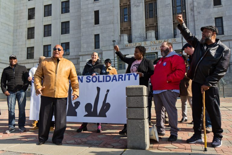 Camden residents opposed to a county take-over of housing inspection and code enforcement rallied in front of Camden City Hall Tuesday. (Kimberly Paynter/WHYY)
