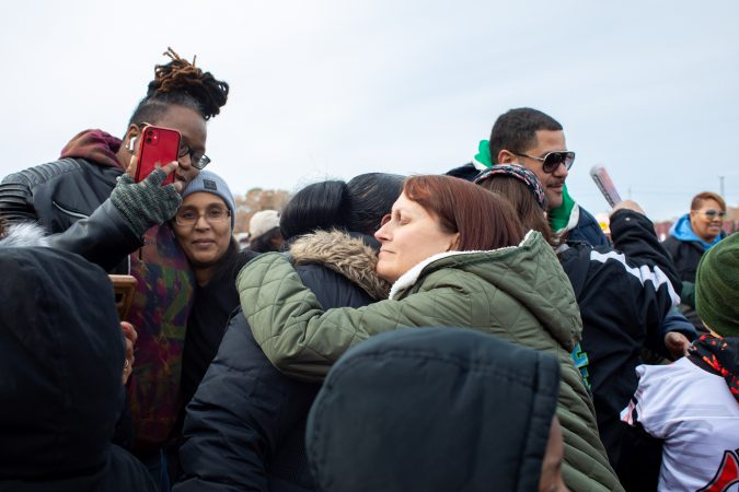 Christine Piper, Egg Harbor City resident and local chapter leader of Moms Demand Action, embraces another attendee at the march. Speakers encouraged unity and love among the community. (Becca Haydu for WHYY)