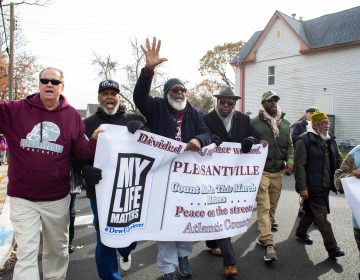A group of male community leaders lead the march in recognition of the particular impact gun violence has on black men in the community. (Becca Haydu for WHYY)