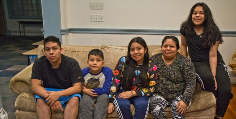 Carmela Apolonio Hernandez, (second from right) with her children Yoselin Artillero Apolonio, 13, (center), Keyri Artillero Apolonio, 15, (right), Edwin Artillero Apolonio, 11, (second from left), and Fidel Artillero Apolonio, 17, (left) in sanctuary at the Germantown Mennonite Church. (Kimberly Paynter/WHYY)