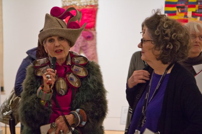 Artist Debra Rapoport speaks about her work at the Off the Wall: American Art to Wear Exhibit. (Kimberly Paynter/WHYY)