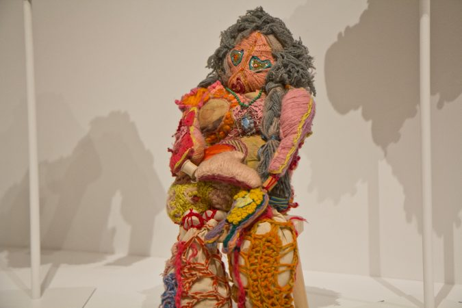 Janet Lipkin's rag doll on display at the Off the Wall: American Art to Wear Exhibit. (Kimberly Paynter/WHYY)