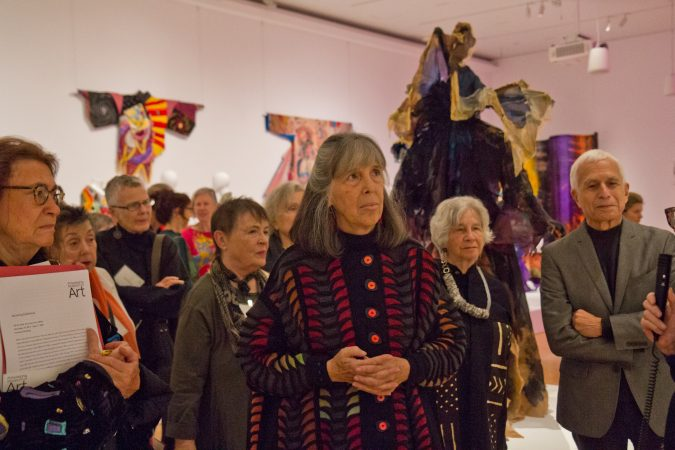 Julie Schafler Dale (center) is the owner of the garment collection in Off the Wall: American Art to Wear, at the Philadelphia Museum of Art. (Kimberly Paynter/WHYY)