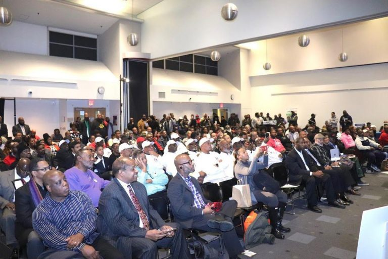Hundreds of men from anti-violence organizations attend #ManUpPHL at Community College of Philadelphia on Monday in an effort to end gun violence. (The Philadelphia Tribune)