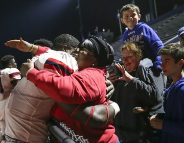 Stony Brook defensive lineman Casey Williams hugs his mother, Zina Williams, while surrounded by friends and family after his team defeated Villanova on Saturday, Oct. 26, 2019. (Heather Khalifa/The Philadelphia Inquirer)