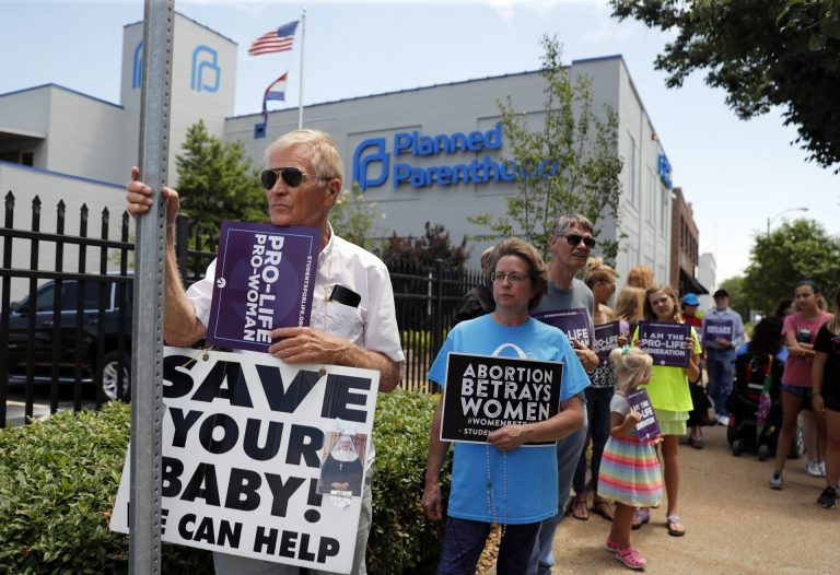 In this June 4, 2019, file photo, Anti-abortion advocates gather outside the Planned Parenthood clinic in St. Louis. (Jeff Roberson / AP Photo)