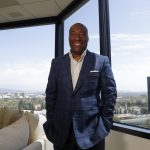 Comedian and media mogul Byron Allen poses for a picture Thursday, Sept. 5, 2019, in Los Angeles. The Supreme Court will hear arguments Nov. 13 in a $20 billion lawsuit Allen filed against Comcast, with the outcome also affecting a $10 billion case he filed against Charter Communications. (Chris Carlson/AP Photo)