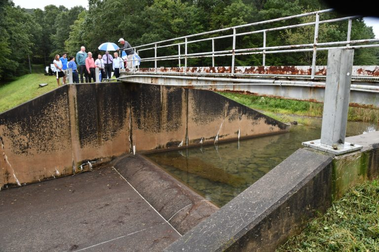 In this Sept. 28, 2019, file photo, officials look at damage to Heller Dam at Hagerman's Reservoir near South Williamsport, Pa. Pennsylvanians who live downstream from its many dams may not often think about what could happen, but inspectors know there are potential threats to life and property along the state's 86,000 miles of streams and rivers. (Mark Nance/Sun-Gazette via AP)