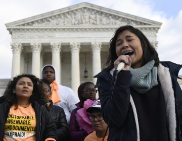 Michelle Lainez, 17, originally from El Salvador but now living in Gaithersburg, Md., speaks during a rally outside the Supreme Court in Washington. (Susan Walsh/AP Photo)