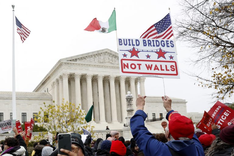 People rally outside the Supreme Court as oral arguments are heard in the case of President Trump's decision to end the Obama-era, Deferred Action for Childhood Arrivals program (DACA), Tuesday, Nov. 12, 2019, at the Supreme Court in Washington. (Jacquelyn Martin/AP Photo)