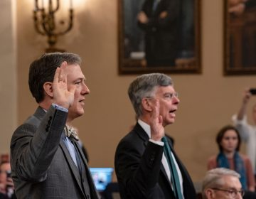Career Foreign Service officer George Kent, left, and top U.S. diplomat in Ukraine William Taylor, right, are sworn in to testify before the House Intelligence Committee on Capitol Hill in Washington, Wednesday, Nov. 13, 2019, during the first public impeachment hearings on President Donald Trump's efforts to tie U.S. aid for Ukraine to investigations of his political opponents. (AP Photo/(AP Photo/J. Scott Applewhite)