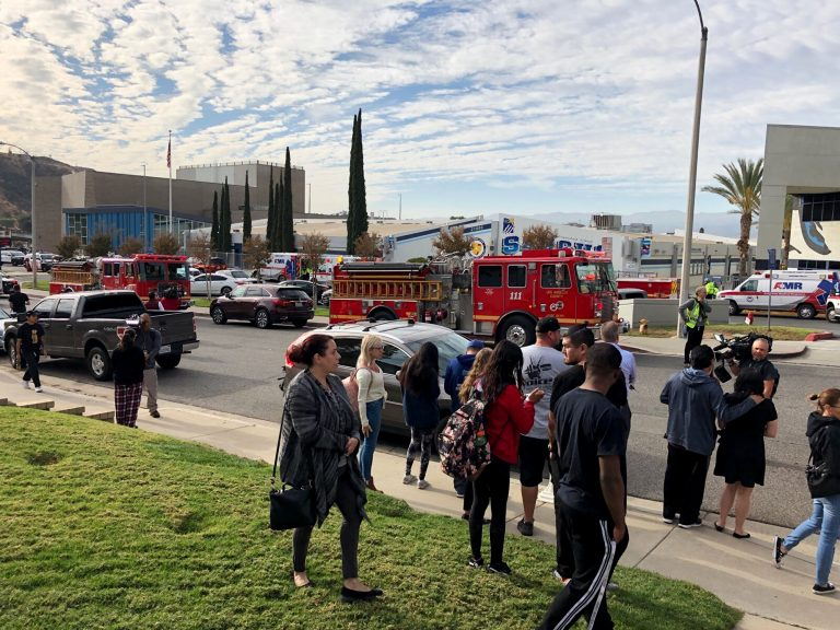 People wait for students and updates outside of Saugus High School after reports of a shooting on Thursday, Nov. 14, 2019, in Santa Clarita, Calif. (Marcio Jose Sanchez/AP Photo)