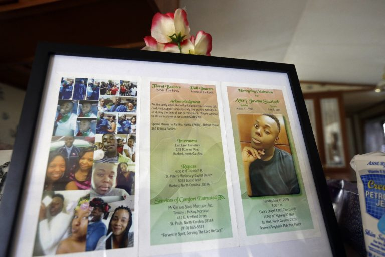 In this photo taken Tuesday, Aug. 6, 2019, a framed copy of Avery Scurlock's memorial is shown in Avery's mother Brenda Scurlock's home in Lumber Bridge, N.C. Avery, who used the name Chanel when dressing as a woman in social settings and hoped to have sex reassignment surgery, was found shot to death in June. This death of a transgender person in North Carolina is one of 18 so far this year, and 17 of the victims have been black women. (Gerry Broome/AP Photo)