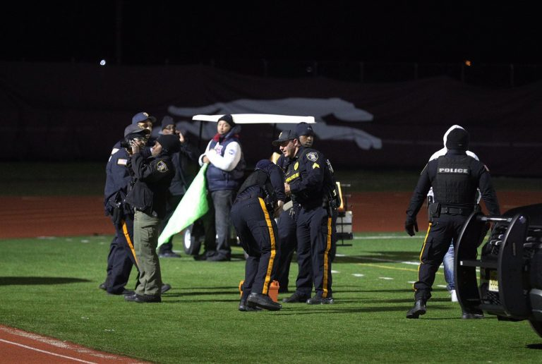 Authorities have charged six men, including the alleged gunman, in connection with a shooting at a New Jersey high school football game. (Edward Lea/The Press of Atlantic City via AP Photos)