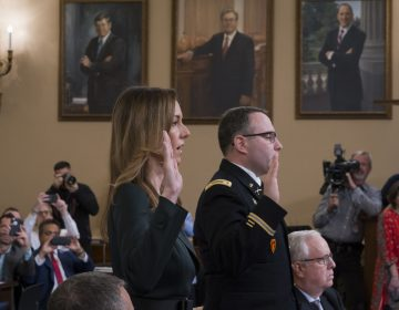 Jennifer Williams, (left), an aide to Vice President Mike Pence, and National Security Council aide Lt. Col. Alexander Vindman, are sworn in to testify before the House Intelligence Committee on Capitol Hill in Washington, Tuesday, Nov. 19, 2019, during a public impeachment hearing of President Donald Trump's efforts to tie U.S. aid for Ukraine to investigations of his political opponents. (J. Scott Applewhite/AP Photo)