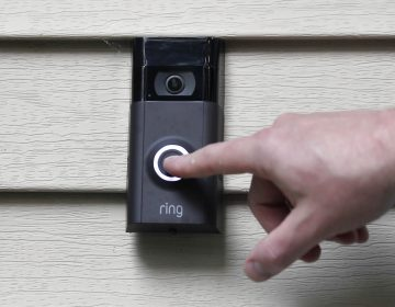 "Amazon says it has considered adding facial recognition technology to its Ring doorbell cameras. The company said in a letter released Tuesday, Nov. 19 by U.S. Sen. Ed Markey that facial recognition is a ""contemplated, but unreleased feature"" of its home security cameras. (Jessica Hill/AP Photo)"