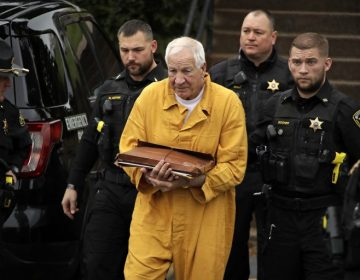 Former Penn State University assistant football coach Jerry Sandusky, center, arrives at the Centre County Courthouse for resentencing on his 45-count child sexual abuse conviction Friday, Nov. 22, 2019. (Gene J. Puskar/AP Photo)