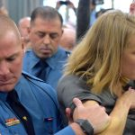 State police remove Sue Altman of New Jersey Working Families from a hearing. (NJ Spotlight)