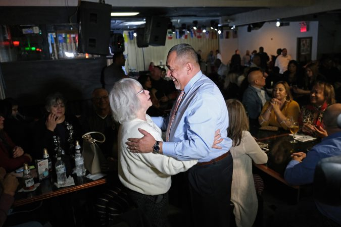 Moran talks to longtime friend Nercida Herrera, left, as supporters gather Nov. 2, 2019 for a campaign event. (Matt Smith for Keystone Crossroads)