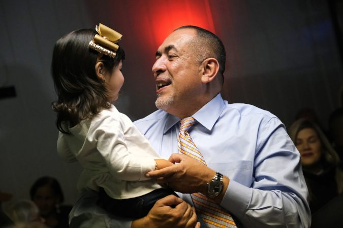 Democratic mayoral candidate Eddie Moran holds his niece Sophia Feliciano, 2, at a campaign event days before polls open. as he is looking to become the first latino mayor of Reading, which has a majority latino population. (Matt Smith for Keystone Crossroads)