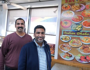 Eat Spice co-owners Vamsi Yaramaka, left, and Raj Alturu stand inside at their truck stop on route 534 off I-80 in White Haven, Pennsylvania. The restaurant offers dishes that are hard to find amid typical American fast food fare. (Matt Smith for Keystone Crossroads)