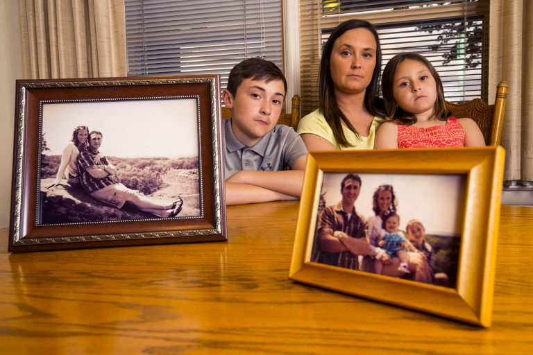 Suzanne Yorty lost her fiancee, partner, and father of her children, Ryan Myers, to a drug overdose in 2016. She is shown with her children, Jarryn, 12, and Sophia, 6.  Ryan would have turned 32 on May 15. On the table are photos taken on Ryan's 27th birthday in 2013. The family was on an outing in Gettysburg. They are shown in their suburban York home.   (Charles Fox / The Philadelphia Inquirer)