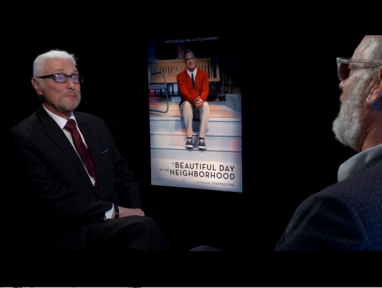 Film critic Patrick Stoner (left) interviews Tom Hanks (right) for his movie,
