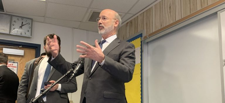Wolf speaks to reporters after an event in Camp Hill on Nov. 13. (Katie Meyer/WITF)