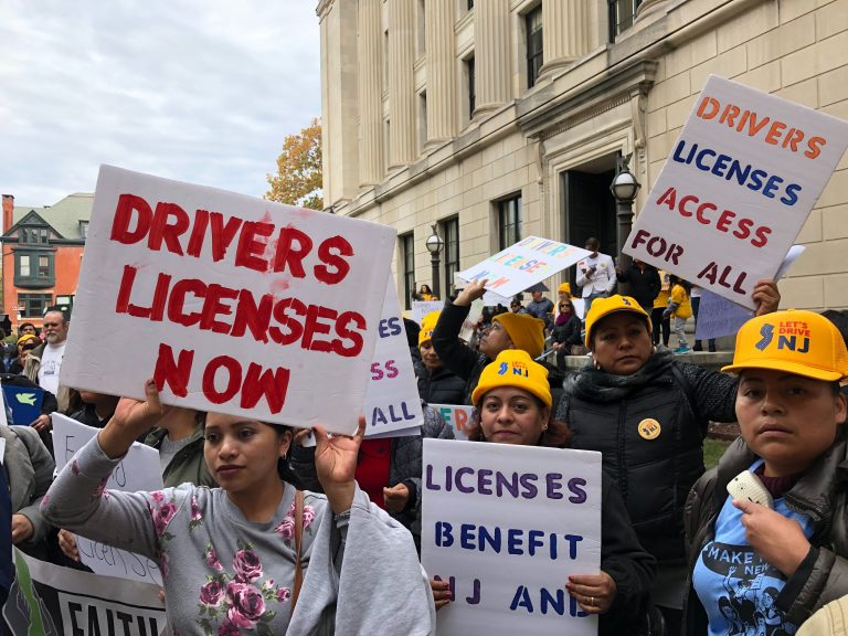 Hundreds rallied outside the Statehouse to push lawmakers to join 13 other states and Washington, D.C. in extending licenses to undocumented immigrants. (Joe Hernandez/WHYY)