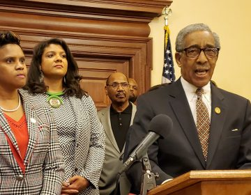 Members of the Legislative Black Caucus, Assemblywomen Shavonda Sumter, left and Britnee Timberlake; Sen. Ron Rice is at the podium. (NJ Spotlight)
