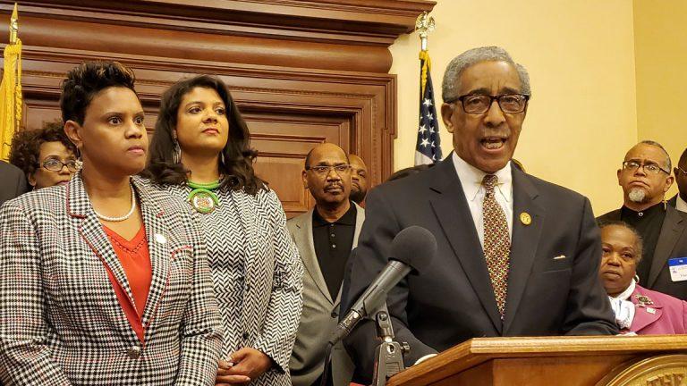 Members of the Legislative Black Caucus, Assemblywomen Shavonda Sumter, left and Britnee Timberlake; Sen. Ron Rice is at the podium. (NJ Spotlight)