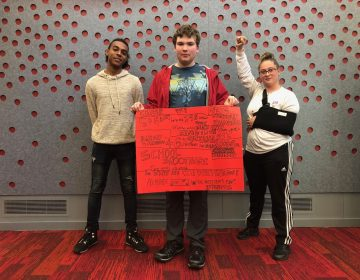 From left, Marshall Everett, Ed Peters, and Sabrina Herb protest the cuts to campus mental health services at HACC, Central Pennsylvania's Community College, on Oct. 23, 2019. (Aneri Pattani/Spotlight PA)