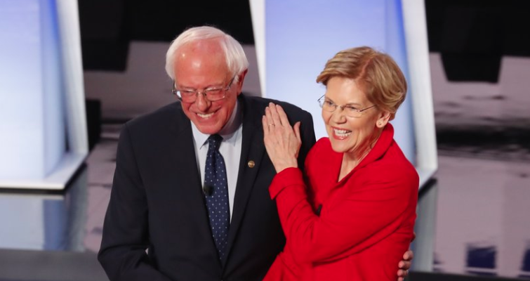 Sen. Bernie Sanders, I-Vt., and Sen. Elizabeth Warren, D-Mass., are proposing to forgive student debt for most Americans. They greet each other at a Democratic primary debate in July. (Paul Sancya/AP Photo)