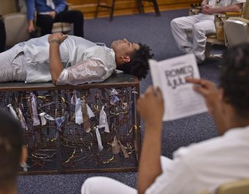 Delaware Shakespeare actor Wilfredo Amill plays the part of Romeo during a performance of Romeo & Juliet held at the Howard R. Young Correctional Institution in Wilmington on Tuesday, November 12, 2019. (Butch Comegys for WHYY)