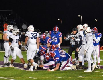 North Schuylkill Spartans and Tamaqua Blue Raiders are in a pile at the end of a play. during a Nov. 8, 2019 playoff game. (Brett Sholtis/WITF)