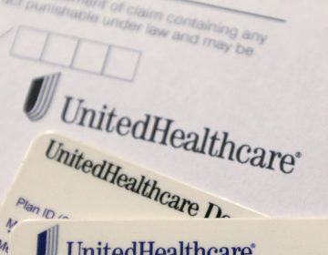 In this Friday, June 15, 2018 file photo, UnitedHealthcare cards and forms are shown in Doral, Fla. (Wilfredo Lee/AP Photo)