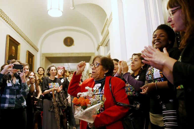 Mercedes Reyes (center), a live-in domestic worker and leader within the Pennsylvania Domestic Workers Alliance, cheers after City Council passed a bill expanding labor protections for domestic workers. (Tim Tai/The Philadelphia Inquirer)