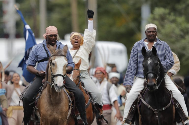 Volunteers participate in a reenactment of what is thought to be the largest slave rebellion in U.S. history in LaPlace, La., on Friday. (Gerald Herbert/AP Photo)