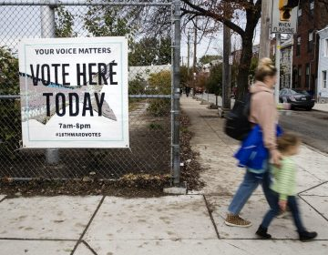 Pedestrians walk past a polling station on Election Day, Tuesday, Nov. 5, 2019 in Philadelphia. (Matt Rourke/AP Photo)