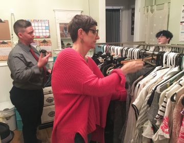 Tristan Vaught (left) and Nancy Dawson are the co-founders of clothing exchange Transform. A 17-year-old client Elliot Reed (far right) was the first customer when the space opened. (Ann Thompson/WVXU)