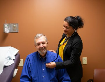 Geriatric oncologist Supriya Gupta Mohile meets with patient Jim Mulcahy at Highland Hospital in Rochester, N.Y.