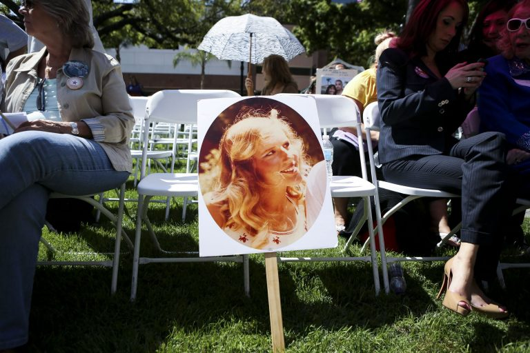 A photo of Marsy Nicholas, the namesake for victim rights legislation that has passed in several states, sits against a chair during a 2013 rally in Santa Ana, Calif. Nicholas was killed in 1983. (Bret Hartman/AP Images for Marsy'sLawForAll.org)