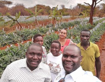 Noah Nasiali-Kadima, foreground, takes a selfie with members of the Africa Farmers Group during a tour of a member's farm in Machakos County, Kenya. (Noah Nasiali-Kadim)