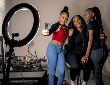 Years ago, Portia Smith (center) suffered postpartum depression and feared seeking care because of child welfare involvement. She and her daughters Shanell Smith (right), 19, and Najai Jones Smith (left), 15, pose for a selfie after makeup artist Najai madeup everyone as they were getting ready at home on Feb. 6, 2019, to go to a movie together. (Tom Gralish/Philadelphia Inquirer)